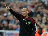 Alex Neil manager of Norwich City gestures during the Barclays Premier League match between Newcastle United and Norwich City at St James' Park on October 18, 2015