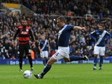 Paul Caddis of Birmingham City scores his sides second goal during the Sky Bet Championship match between Birmingham City and Queens Park Rangers at St Andrews on October 17, 2015 in Birmingham, England.