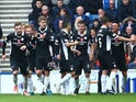 Derek Lyle (R) of Queen of the South celebrates scoring a goal during the first half of the Scottish Championship match between Glasgow Rangers FC and Queen of the South FC at Ibrox Stadium on October 17, 2015