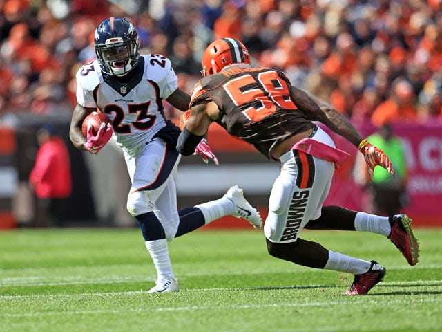 Running back Ronnie Hillman #23 of the Denver Broncos runs the ball during the first quarter towards inside linebacker Chris Kirksey #58 of the Cleveland Browns at Cleveland Browns Stadium on October 18, 2015