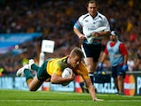 Drew Mitchell of Australia scores his teams second try during the 2015 Rugby World Cup Quarter Final match between Australia and Scotland at Twickenham Stadium on October 18, 2015 in London, United Kingdom.