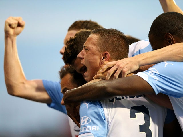 Sydney FC team mates celebrate a goal during the round two A-League match between the Newcastle Jets and Sydney FC at Hunter Stadium on October 17, 2015