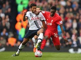 Divock Origi of Liverpool and Mousa Dembele of Tottenham Hotspur compete for the ball during the Barclays Premier League match between Tottenham Hotspur and Liverpool at White Hart Lane on October 17, 2015