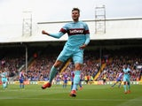 Carl Jenkinson of West Ham United celebrates scoring his team's first goal during the Barclays Premier League match between Crystal Palace and West Ham United at Selhurst Park on October 17, 2015