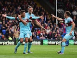 Manuel Lanzini (L) of West Ham United celebrates scoring his team's second goal with his team mates Andy Carroll (C) and Aaron Cresswell (R) during the Barclays Premier League match between Crystal Palace and West Ham United at Selhurst Park on October 17