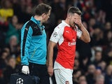 Arsenal's Welsh midfielder Aaron Ramsey (R) leaves the pitch injured during the UEFA Champions League football match between Arsenal and Bayern Munich at the Emirates Stadium in London, on October 20, 2015.