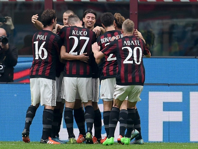 Carlos Bacca of AC Milan (C) celebrate after scoring the opening goal during the Serie A match between AC Milan and US Sassuolo Calcio at Stadio Giuseppe Meazza on October 25, 2015 in Milan, Italy.