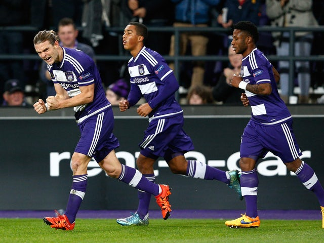 Guillaume Gillet (L) of Anderlecht celebrates after scoring a goal to level the scores at 1-1 during the UEFA Europa League Group J match between RSC Anderlecht and Tottenham Hotspur FC at the Constant Vanden Stock Stadium on October 22, 2015