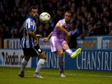 Andrew Taylor of Readind is challenged by Ross Wallace of Sheffield Wednesday during the Sky Bet Championship match between Sheffield Wednesday and Reading at Hillsborough Stadium on August 19, 2015