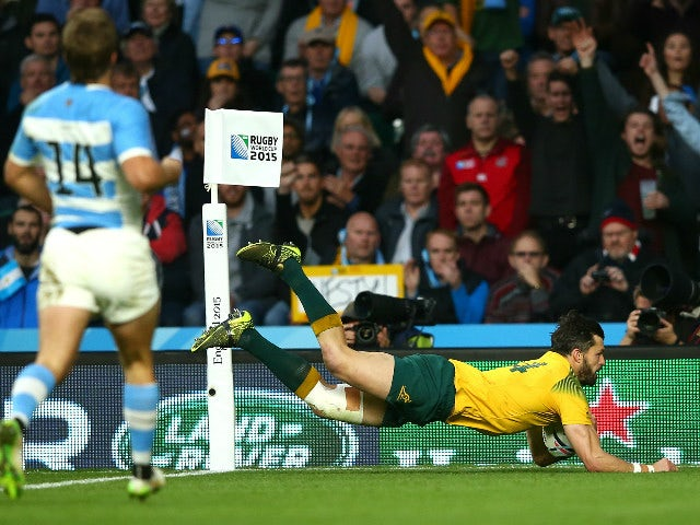 Adam Ashley-Cooper of Australia dives over to score his sides third try during the 2015 Rugby World Cup Semi Final match between Argentina and Australia at Twickenham Stadium on October 25, 2015 in London, United Kingdom.