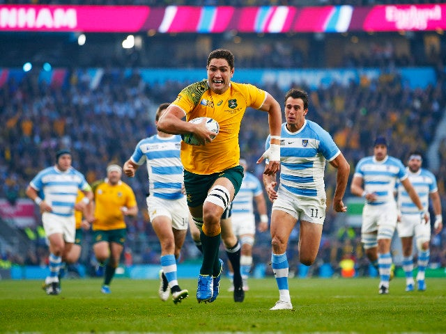 Rob Simmons of Australia races through to score the opening try during the 2015 Rugby World Cup Semi Final match between Argentina and Australia at Twickenham Stadium on October 25, 2015 in London, United Kingdom.