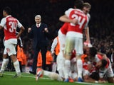 Arsenal's French manager Arsene Wenger (2L) reacts as his players celebrate Arsenal's German midfielder Mesut Ozil goal during the UEFA Champions League football match between Arsenal and Bayern Munich at the Emirates Stadium in London, on October 20, 201