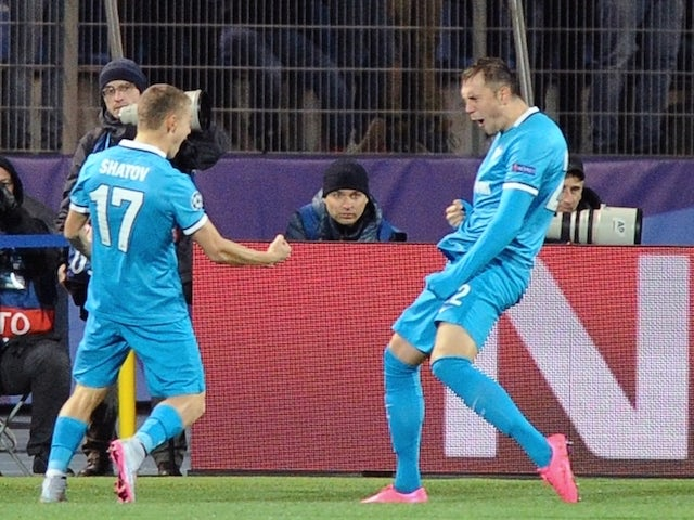 Zenit's Russian forward Artem Dzyuba (R) celebrates after scoring a goal during the UEFA Champions League group H football match between FC Zenit and Olympique Lyonnais at the Petrovsky stadium in St. Petersburg on October 20, 2015.