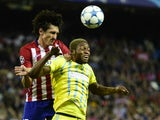 Astana's Congolese forward Junior Kabananga (R) vies with Atletico Madrid's Montenegrin defender Stefan Savic during the UEFA Champions League group C football match Club Atletico de Madrid vs FC Astana at the Vicente Calderon stadium in Madrid on October