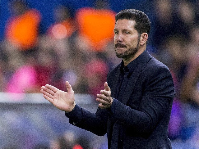 Head coach Diego Pablo Simeone of Atletico de Madrid claps during the UEFA Champions League Group C match between Club Atletico de Madrid and FC Astana at Vicente Calderon stadium on October 21, 2015 in Madrid, Spain.