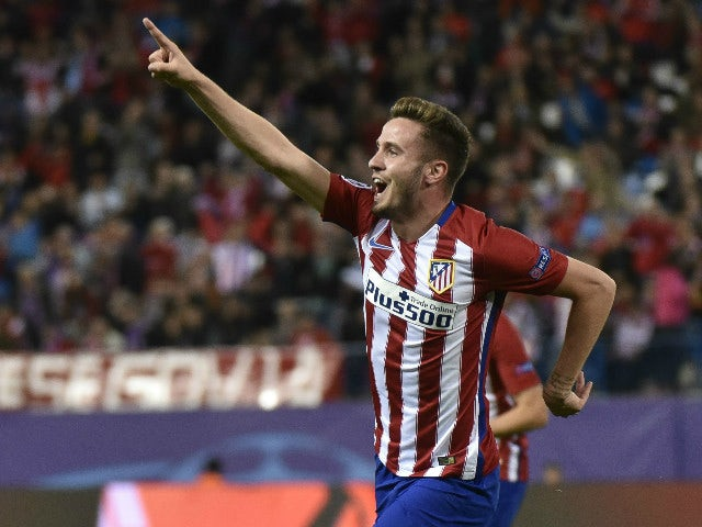 Atletico Madrid's midfielder Saul Niguez celebrates scoring during the UEFA Champions League group C football match Club Atletico de Madrid vs FC Astana at the Vicente Calderon stadium in Madrid on October 21, 2015.