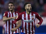 Yannick Carrasco of Atletico de Madrid celebrates scoring their second goal during the La Liga amtch between Club Atletico de Madrid and Valencia CF at Vicente Calderon Stadium on October 25, 2015