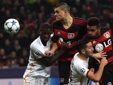 Leverkusen's Greek defender Kyriakos Papadopoulos, Leverkusen's defender Jonathan Glao Tah (R) vie with Roma´s Antonio Ruediger (L) and Kostas Manolas during the Group E, first-leg UEFA Champions League football match Bayer Leverkusen vs AS Roma in Lev