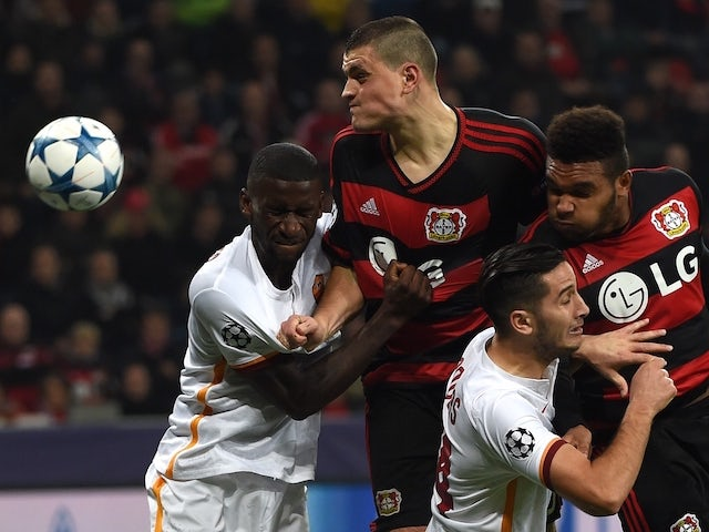 Leverkusen's Greek defender Kyriakos Papadopoulos, Leverkusen's defender Jonathan Glao Tah (R) vie with Roma�s Antonio Ruediger (L) and Kostas Manolas during the Group E, first-leg UEFA Champions League football match Bayer Leverkusen vs AS Roma in Lev