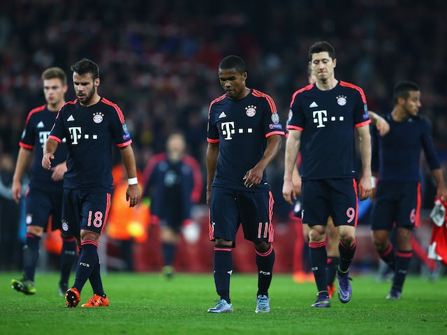 Juan Bernat (18), Douglas Costa (11) and Robert Lewandowski of Bayern Munich (9) look dejected in defeat after the UEFA Champions League Group F match between Arsenal FC and FC Bayern Munchen at Emirates Stadium on October 20, 2015 in London, United Kingd