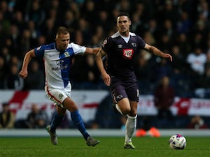 Jordan Rhodes (L) of Blackburn Rovers in action with Jason Shackell of Derby County during the Sky Bet Championship match between Blackburn Rovers and Derby County at Ewood Park on October 21, 2015 in Blackburn, England.