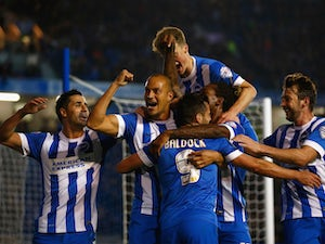 Bobby Zamora of Brighton celebrates with team mates after scoring during the Sky Bet Championship match between Brighton & Hove Albion and Bristol City at Amex Stadium on October 20, 2015 in Brighton, England