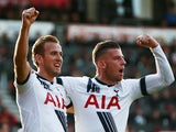 Harry Kane (L) of Tottenham Hotspur celeberates scoring his team's fifth and hat trick goal with his team mate Toby Alderweireld (R) during the Barclays Premier League match between A.F.C. Bournemouth and Tottenham Hotspur at Vitality Stadium on October 2