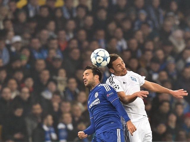 Chelsea's Spanish midfielder Cesc Fabregas (L) vies with Dynamo Kiev's Ukrainian midfielder Serhiy Rybalka during the UEFA Champions League football match Dynamo Kiev vs Chelsea, on October 20, 2015 at the Olympic stadium in Kiev.