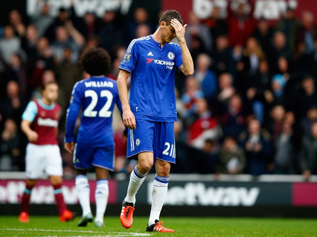 Nemanja Matic of Chelsea leaves the pitch after being shown a red card during the Barclays Premier League match between West Ham United and Chelsea at Boleyn Ground on October 24, 2015