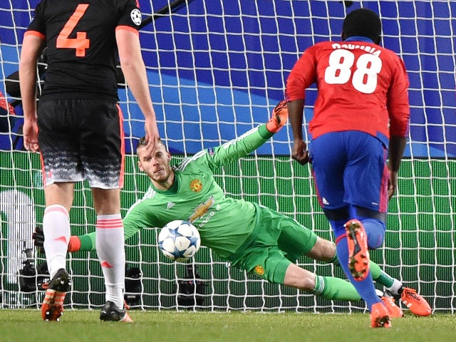 Manchester United's Spanish goalkeeper David De Gea misses to stop a goal during the UEFA Champions League group B football match between PFC CSKA Moscow and FC Manchester United at the Arena Khimki stadium outside Moscow on October 21, 2015.