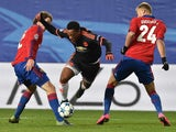 CSKA Moscow's Brazilian defender Mario Fernandes (L) and CSKA Moscow's Russian defender Vasily Berezutskiy (R) vie for the ball with Manchester United's French forward Anthony Martial during the UEFA Champions League group B football match between PFC CSK