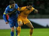 BATE Borisov's Belarusian forward Mikhail Gordeychuk (L) vies for the ball with Barcelona's Brazilian defender Dani Alves during the UEFA Champions League group E football match between FC BATE Borisov and FC Barcelona at the Borisov Arena stadium outside
