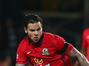 QPR's Charlie Austin looks to break away from Danny Guthrie of Blackburn during the Sky Bet Championship match between Queens Park Rangers and Blackburn Rangers at Loftus Road on September 16, 2015