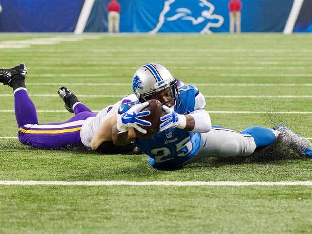 Harrison Smith #22 of the Minnesota Vikings stops Theo Riddick #25 of the Detroit Lions at the goal line during the first quarter at an NFL game at Ford Field on October 25, 2015