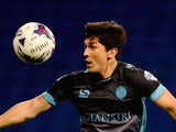 Fernando Forestieri of Sheffield Wednesday is tackled by Lawrie Wilson of Bolton during the Sky Bet Championship match between Bolton Wanderers and Sheffield Wednesday at Reebok Stadium on September 15, 2015