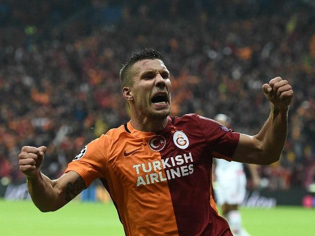Galatasaray's German forward Lukas Podolski celebrates scoring during the UEFA Champions League football match between Galatasaray AS and SL Benfica at the Ali Sami Yen Spor Kompleks stadium in Istanbul on October 21, 2015.