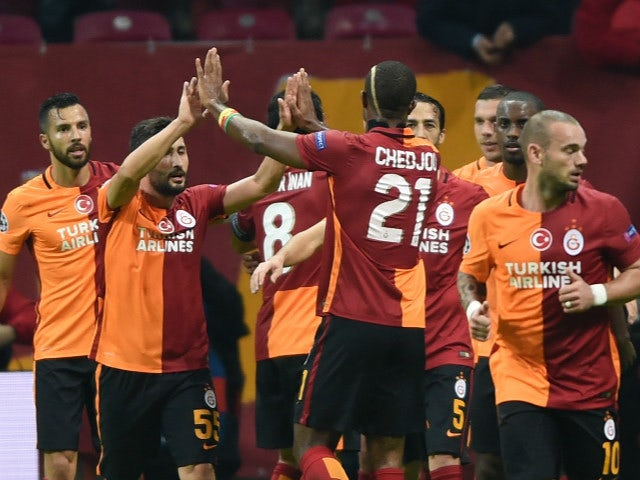 Galatasaray players celebrate after Galatasaray's German forward Lukas Podolski scored the second goal during the UEFA Champions League football match between Galatasaray AS and SL Benfica at the Ali Sami Yen Spor Kompleks stadium in Istanbul on October 2