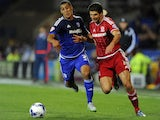 George Friend of Middlesbrough is tackled by Lee Peltier of Cardiff City during the Sky Bet Championship match between Cardiff City and Middlesbrough at the Cardiff City Stadium on October 20, 2015 in Cardiff, Wales.