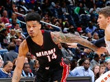 Gerald Green #14 of the Miami Heat drives against Kyle Korver #26 of the Atlanta Hawks at Philips Arena on October 18, 2015