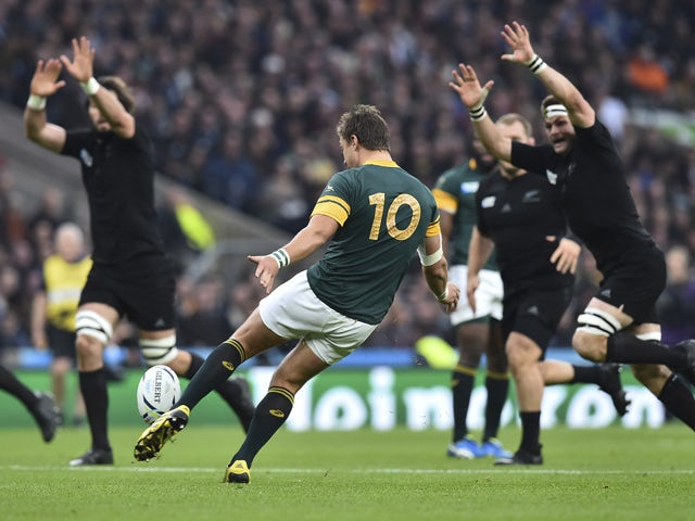 South Africa's fly half Handre Pollard (C) kicks the ball during a semi-final match of the 2015 Rugby World Cup between South Africa and New Zealand at Twickenham Stadium, southwest London, on October 24, 2015