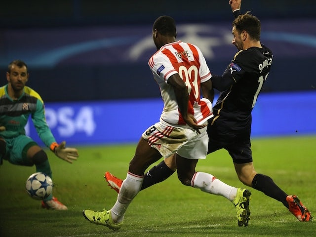 Olympiakos' Nigerian player Ideye Brown (C) shoots to score during the UEFA Champions League football match between Dinamo Zabreb and Olympiakos at the Stadion Maksimir stadium in Zagreb on October 20, 2015.