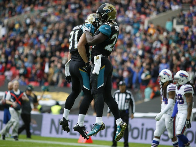 TJ Yeldon #24 of Jacksonville Jaguars celebrates a touchdown during the NFL game between Jacksonville Jaguars and Buffalo Bills at Wembley Stadium on October 25, 2015