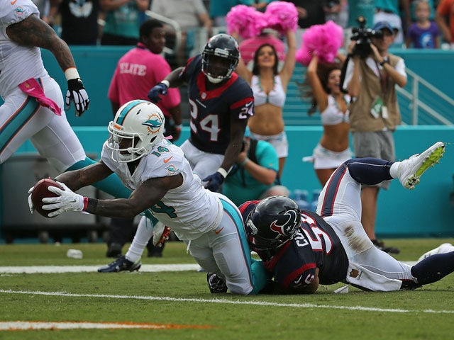Jarvis Landry #14 of the Miami Dolphins rushes for a touchdown during a game against the Houston Texans at Sun Life Stadium on October 25, 2015
