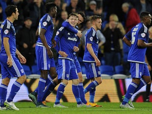 Joe Mason of Cardiff City celebrates his sides first goal with Sean Morrison of Cardiff City as he deflected the ball onto George Friend of Middlesbrough for an own goal during the Sky Bet Championship match between Cardiff City and Middlesbrough at the C