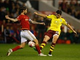 Joey Barton of Burnley tackles Henri Lansbury of Nottingham Forest during the Sky Bet Championship match between Nottingham Forest and Burnley at City Ground on October 20, 2015 in Nottingham, England.