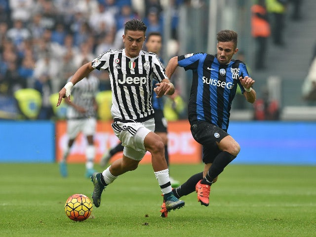 Paulo Dybala (L) of Juventus FC in action against Marco D Alessandro of Atalanta BC during the Serie A match between Juventus FC and Atalanta BC at Juventus Arena on October 25, 2015 in Turin, Italy.