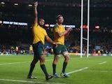 Sekope Kepu and Kane Douglas of Australia celebrate after winning the 2015 Rugby World Cup Semi Final match between Argentina and Australia at Twickenham Stadium on October 25, 2015