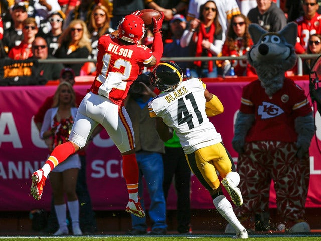 Albert Wilson #12 of the Kansas City Chiefs makes a catch over Antwon Blake #41 of the Pittsburgh Steelers at Arrowhead Stadium during the game on October 25, 2015