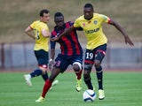 Ajaccio's Guinean defender Issiaga Sylla (L) vies with Sochaux's French midfielder Karl Toko Ekambi (R) during the friendly football match Sochaux (FCSM) against Ajaccio (GFCA) on July 24, 2015, at the Jean Bouloumie Stadium in Vittel, eastern France.