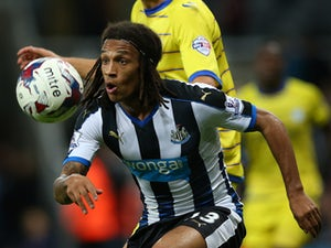 Kevin Mbabu of Newcastle vies with Atdhe Nuhiu of Sheffield Wednesday during the Capital One Cup Third Round match between Newcastle United and Sheffield Wednesday at St James Park on September 23, 2015